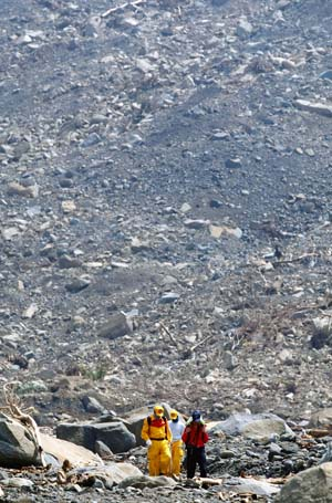 Rescue workers searching for victims of mudslide that buried Xiaolin ...