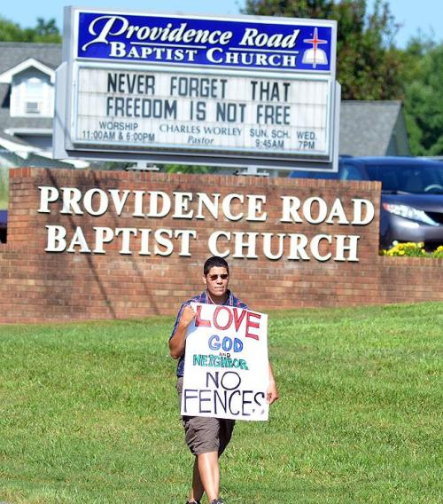 Kessiah Young is one of nearly 2000 to picket Worley (credit Jeremy Detter for Record Photo)