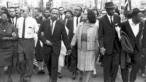Martin Luther King and Corretta Scott King leading a protest march