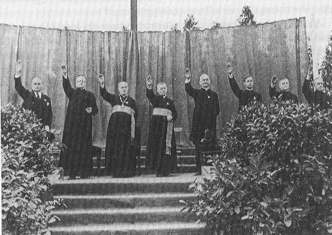Clergy attending a religious Youth Rally for Jesus saluting Adolf Hitler