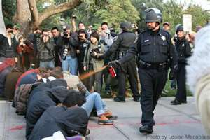 Lt. John Pike of University of California Davis pepper sprays mace into eyes of demonstrators