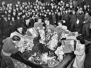 Young Americans burn comic books in Nazi fashion